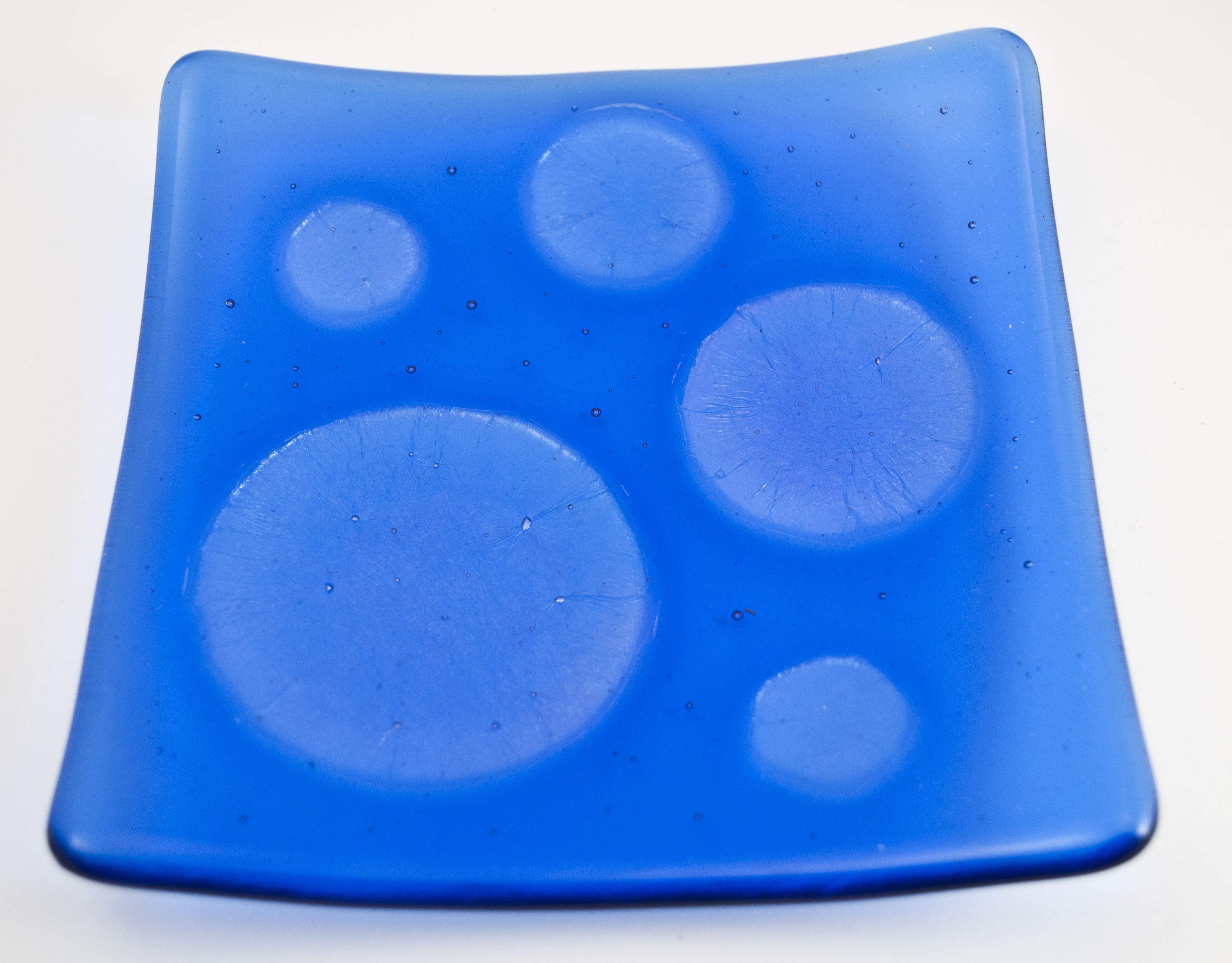 Blue dish with clear irid circles